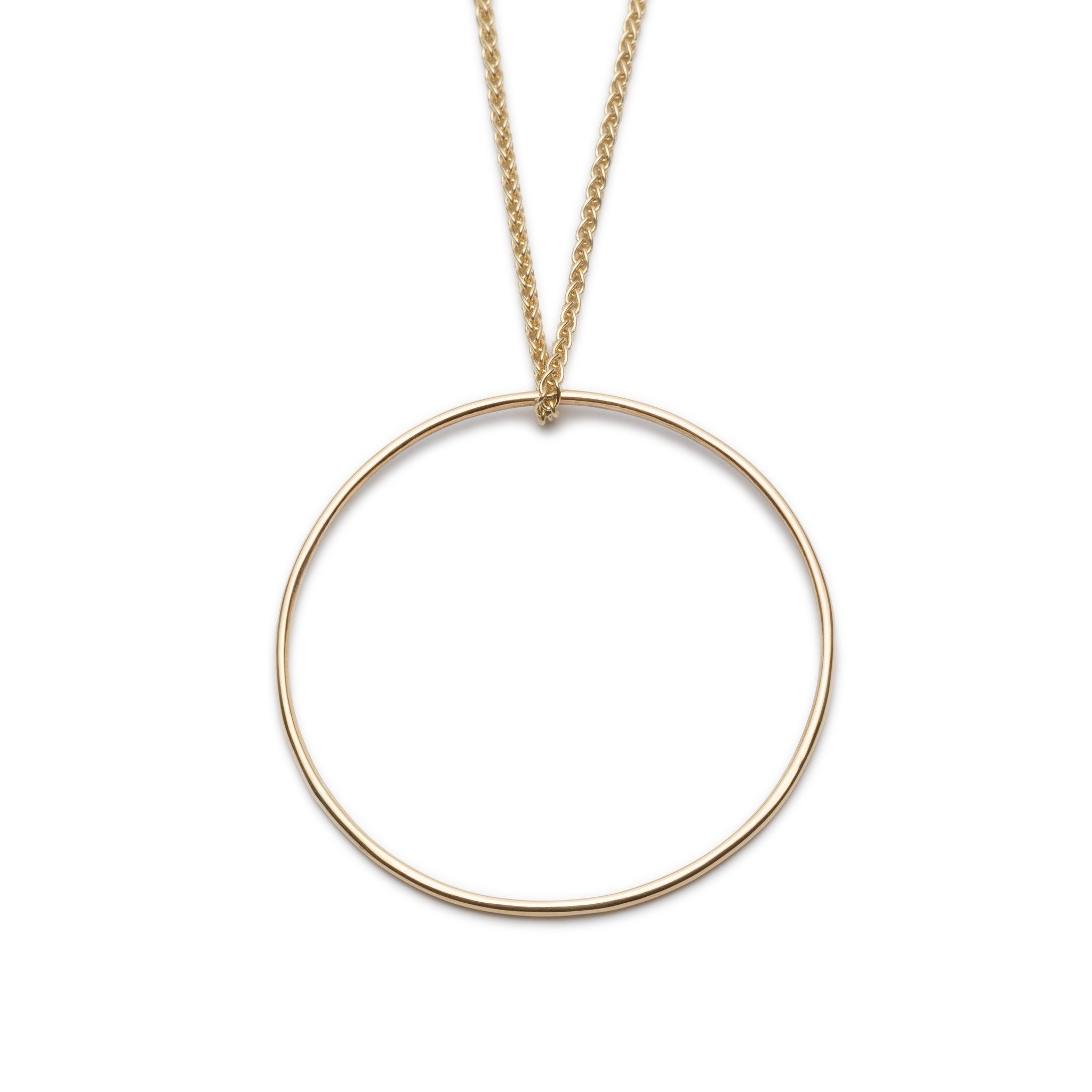 Large Circle Pendant. Material: 9ct Yellow Gold. Measurements: Pendant is 32mm outside diameter, spiga chain is 18