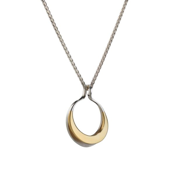 Circle of Dreams Small Silver & Gold Pendant. Material: Sterling silver & 9ct yellow gold, spiga chain. Measurements: 22mm across, 29 mm in length. Design Year: 2012